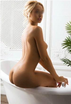 Nicole offers topless and naturist massage
